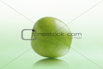 Green apple on white-green background