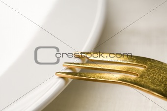 Gold fork on a plate