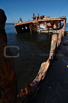 A sunken wreck rusting into the ocean