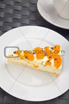 slice of tangerine cream cake on a white plate