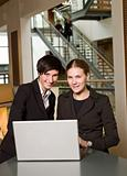 Businesswomen in front of a laptop