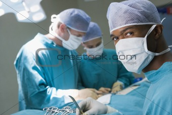 Four Surgeons Getting Ready To Operating On A Patient