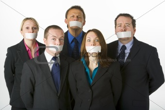 Group Of Business People With Their Mouths Taped Shut