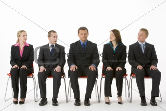 Group Of Business People Sitting In A Line