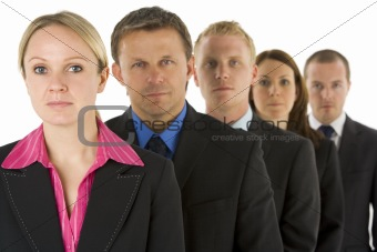 Group Of Business People In A Line Looking Serious