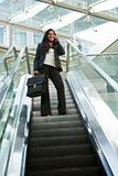 Businesswoman on an Escalator