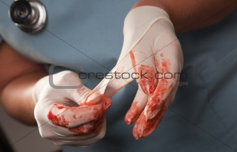 Abstract of Doctors Bloody Surgical Gloves, Scrubs and Stethoscope.