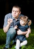 Father Blowing Soap Bubble