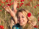 Barefoot blonde in poppies