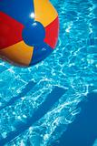 Beachball in a beautiful blue swimming pool