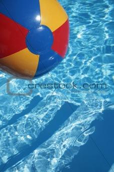 Beachball in a beautiful blue swimming pool