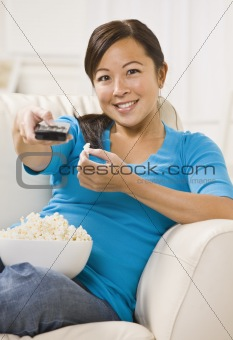 Beautiful Asian Woman Watching T.V.