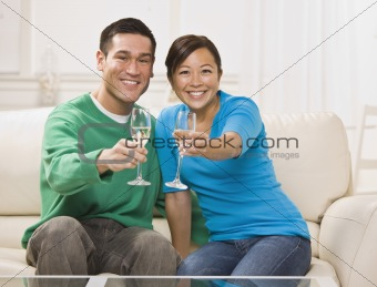 Attractive Asian Couple Toasting