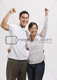 Attractive Asian Couple Cheering