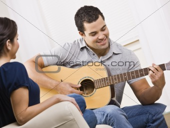 Happy Young Couple with Guitar