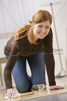 Cute Redhead Woman Cleaning Up a Spill