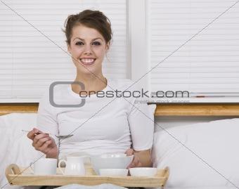Attractive Brunette with Breakfast in Bed