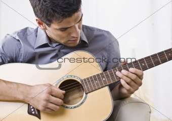 Attractive Man Playing Guitar