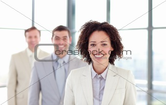 Smiling businesswoman leading her colleagues