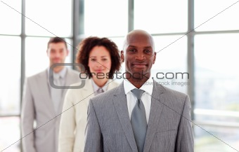 Smiling African-American businessman leading his colleagues