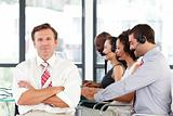 Senior leadership with crossed arms in a call center