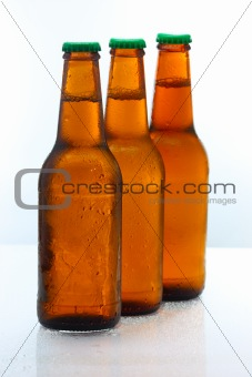 Three beer bottles abreast