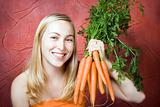 Smiling woman with fresh carrots
