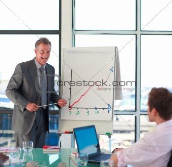 Smiling senior businessman in a presentation