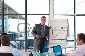 Mature businessman giving a presentation