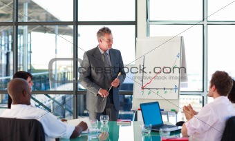 Mature manager in a meeting