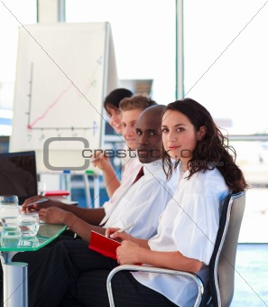 Business people in an office looking at the camera