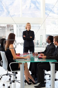 Confident businesswoman smiling at the camera in a meeting