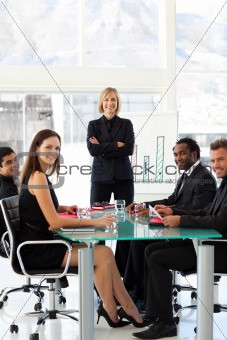 Business people smiling at the camera in a meeting