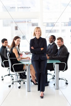 Business team smiling at the camera in a meeting