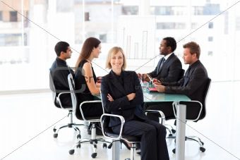 Cofident businesswoman sitting with foded arms in a meeting