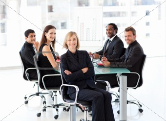 Smiling business people sitting in a presentation