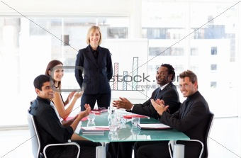 Business people applauding in a presentation