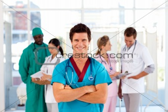 Attractive doctor with is team in the background