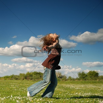 Young girl having fun in a park