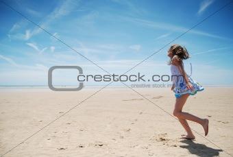 Young girl having fun on the beach