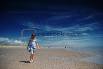 Young girl having fun on the beach