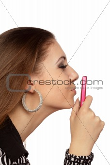 Attractive woman kissing her mobile phone