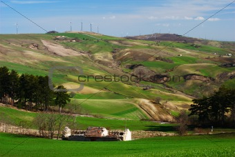 Green hills and wind turbines