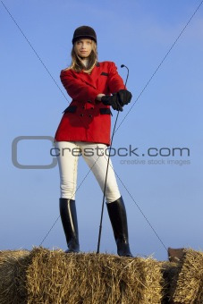 girl jockey / on a background of blue sky