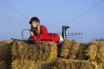 girl jockey / on a background of blue sky and hay