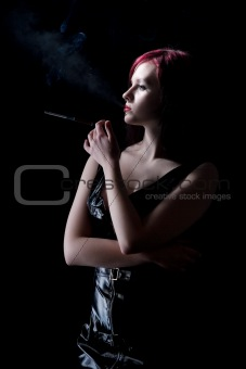 beautiful woman smokes a cigarette with a mouthpiece