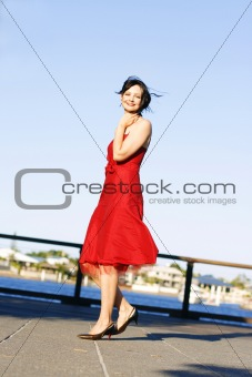 Beautiful woman in a red dress outdoors.