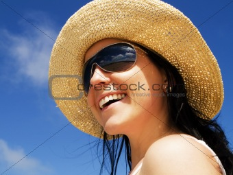 woman in sunhat on the blue sky
