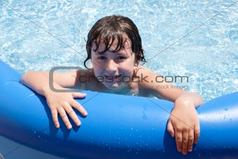 Adorable little boy in the swimming-pool