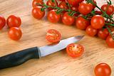Tomatoes on wooden chopping board